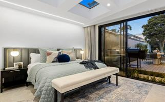 Master bedroom with sliding door, view of pool and four skylights