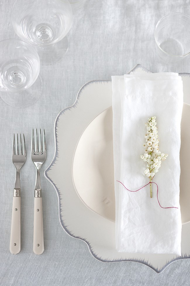 9\. Classic and elegant, you can't go wrong with all white. Create texture with linens or tie a piece of string around a white flower for a lovely keepsake for guests.   Photo: Craig Wall