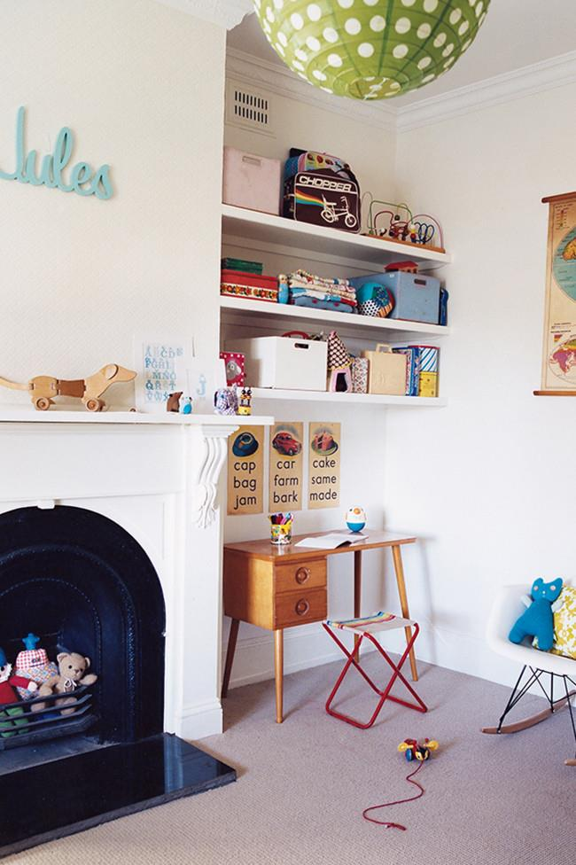 Try mixing up the way you store toys on shelves - display current favourites and pack others away in coloured boxes. Take advantage of structural features like disused fireplaces, a great place to store toys!