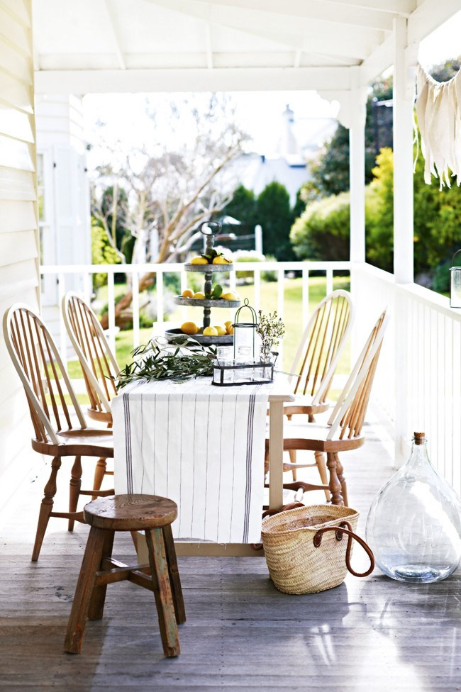 **5\. A neutral setting**  Embrace the outdoors but benefit from shelter by setting up a table on a verandah. By using neutral toned linens and wooden furniture you can change the look of your table setting by adding bright flowers, accent napkins or coloured crockery and glassware.