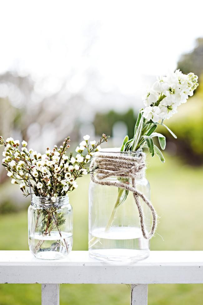 Repurpose old jars and use them for vases – simply tie twine around the top of a jar and add a sprig of your favourite bloom.
