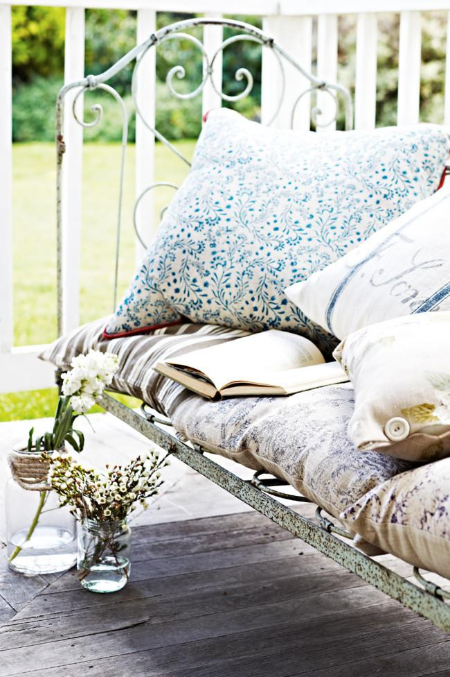 """Look at an old bed frame in a new way. This rustic frame has been converted into a [dreamy daybed](https://www.homestolove.com.au/daybed-ideas-19586