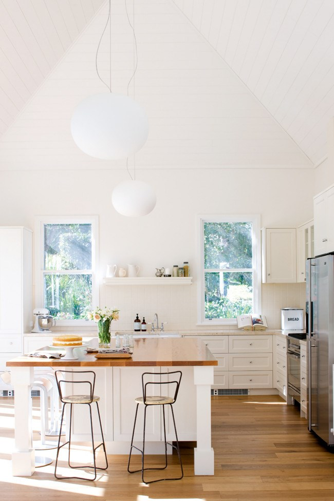 This spacious kitchen is filled with natural light, beautiful appliances and features a soaring pitched ceiling. *Photo: Sam McAdam-Cooper*