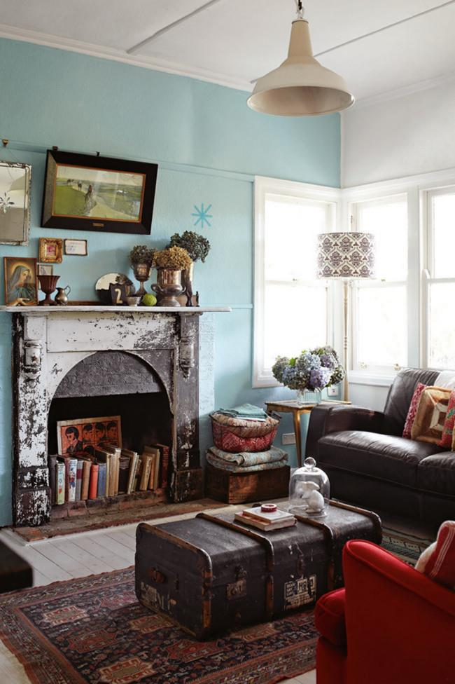 """Silverware and a Madonna print share the mantelpiece in this home which is decorated according a [vintage bohemian](https://www.homestolove.com.au/a-bohemian-home-with-vintage-charm-4321