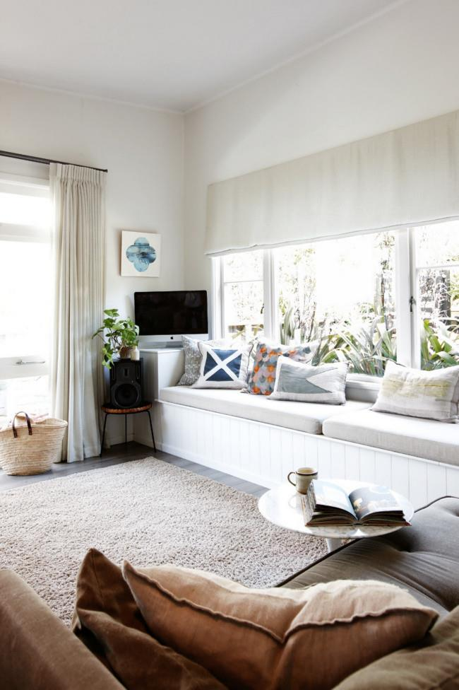 """""""In the right place, an object can look wonderful,"""" says stylist Anna Church who chose Resene's 'Wan White' for the walls as a backdrop for decorative displays. Her husband, Nick, built the window seat, adding room for hidden storage."""