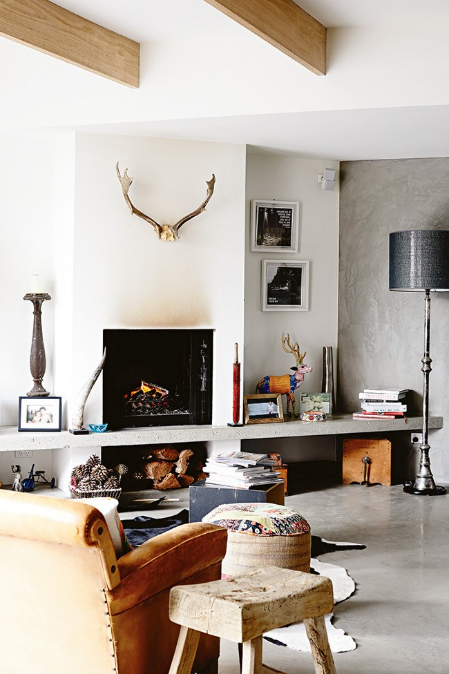 **Living area**Concrete was used for the flooring and the fireplace shelf. The grey tones work well against the natural timber. | Photo: Derek Swalwell