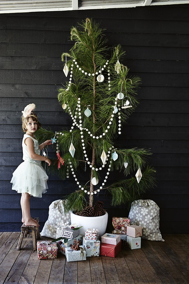**Pared back Christmas tree decorations:** While this may sound contradictory, let those patterned presents and colourful decorations pop by stripping back swathes of tinsel from the tree. Simple is key.