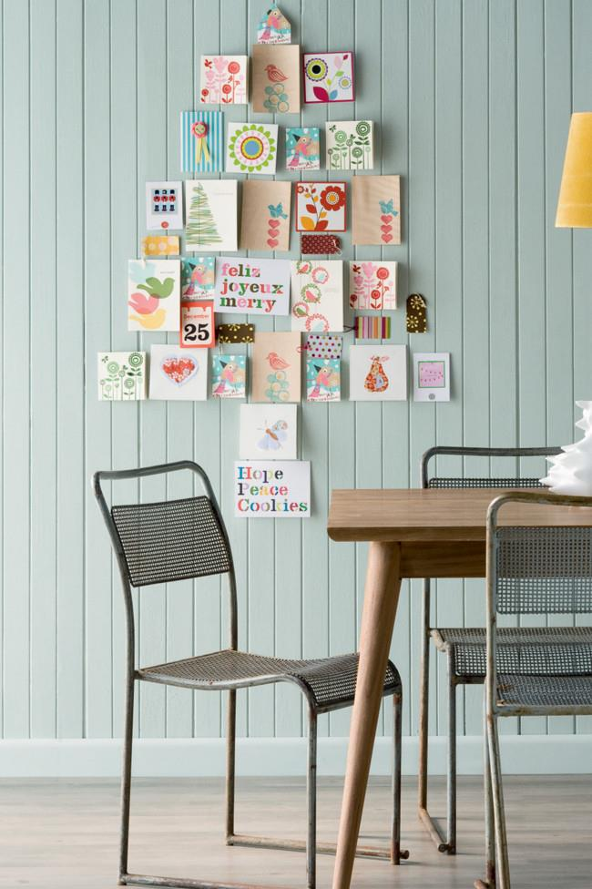"**Christmas card tree:** You probably already have a stack of [Christmas cards](https://www.homestolove.com.au/christmas-cards-2019-18357|target=""_blank""), so why not upcycle them and build this year's tree from the words others have given to you? Use Blu-Tack to stick the cards to the wall, and watch your tree grow (literally)."