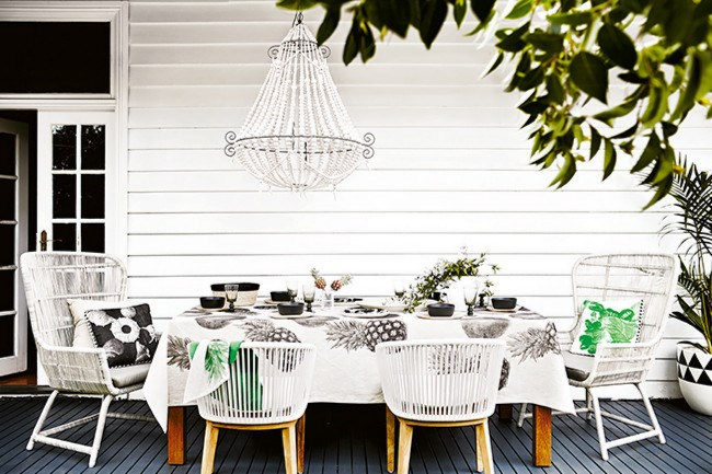 **Warmer weather is the perfect excuse for alfresco dining. Here are 10 table decorating ideas to help make your next outdoor entertaining event a hit!**  **1\. Fine dining**  You can mirror the formality of indoor dining rooms by using a tablecloth and by placing larger occasional chairs at either end of your dining table. Both elements will lend a sense of occasion to your soiree. | Photo: Alicia Taylor