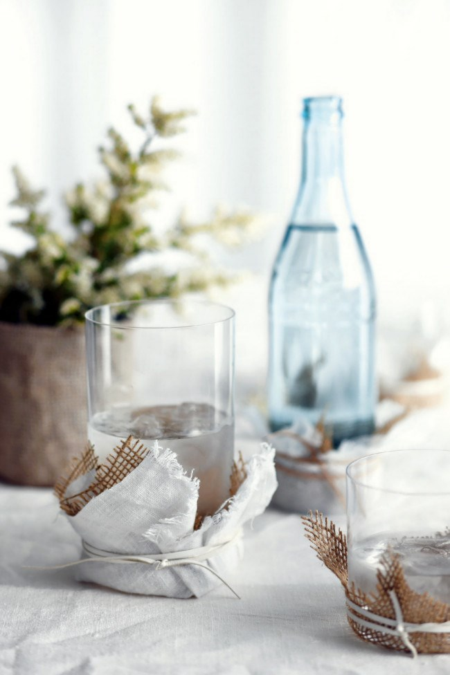 **10\. DIY**  Wrap glasses in fabric for a simple decorative element. Using textiles with varied texture and tone not only ensures that no moisture escapes, but also makes for a tactile contrast. Echo the tumbler coasters with jugs or vases for a stronger link to the overall theme. | Photo: Guy Bailey