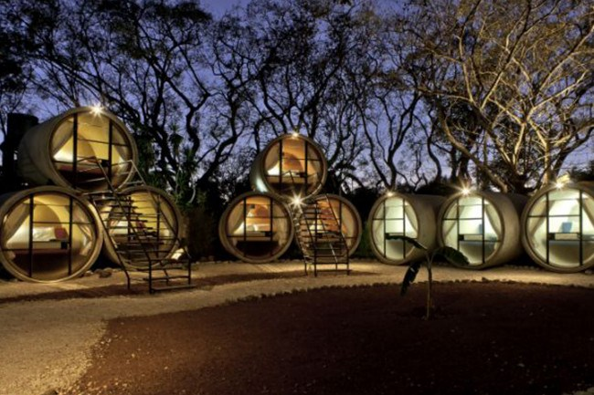 Tubohotel, Mexico. Inside these cool concrete tubes you'll find a queen bed, desk light, fan, and under-bed storage as well as towels and blankets. What more do you need?