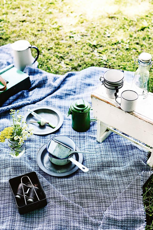**Stylish picnicware**  Create a laid-back luxe feel with a few considered pieces like wicker baskets, natural tablecloths and vintage details such as enamel pitchers.