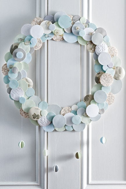 A homemade wreath using paper, wallpaper, button and thread. Why not use off-cuts or recycled Christmas paper? | Photo: Sam McAdam-Cooper