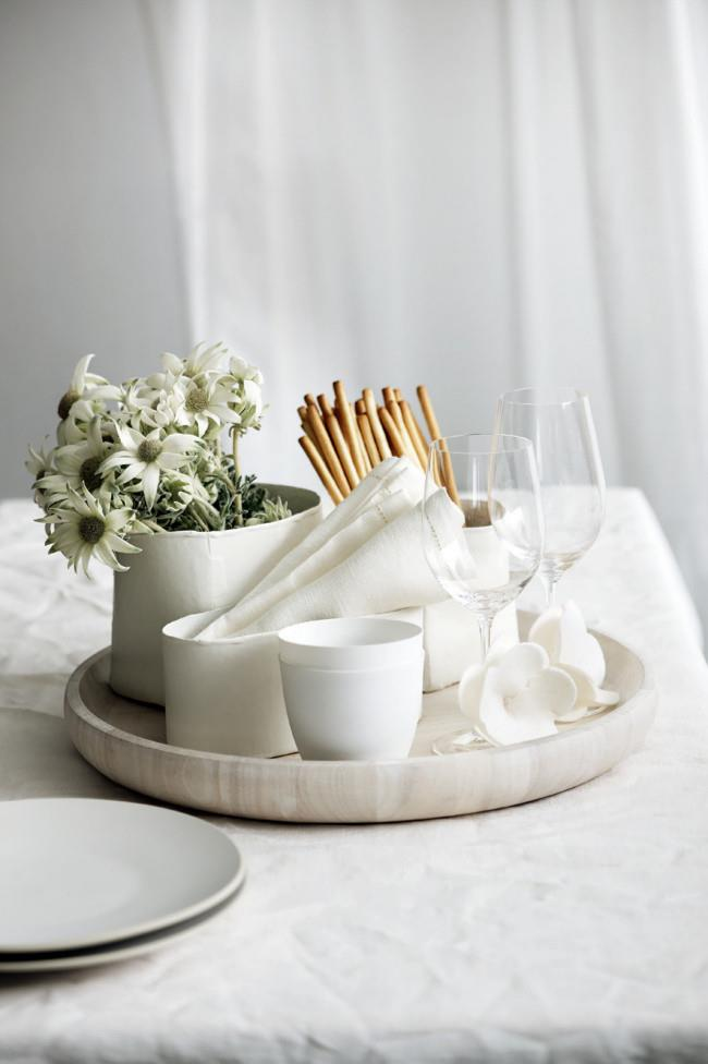 **Use special pieces:** Bring out whatever it is you usually don't have. Like if you're a non-table cloth house, bring out a linen one. Swap glassware for crystal or use vintage egg cups. *Photo:* Guy Bailey