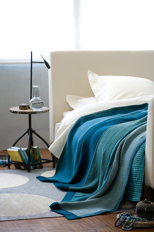 Knit your very own winter blanket! This modern take on a traditional patchwork blanket is resplendent in rich teals and peacock green. [How to knit a blanket](http://www.homelife.com.au/craft-diy/knitting-sewing/how-to-knit-a-blanket) | Photo: Scott Hawkins