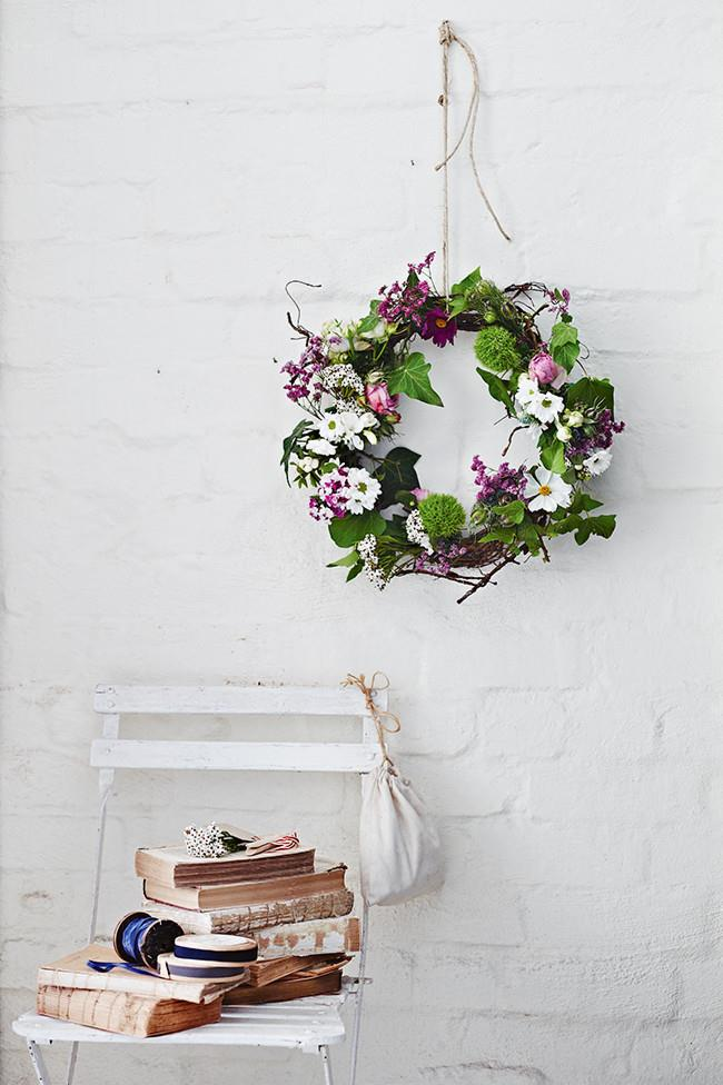 Floral wreath. Think past just displaying flowers in vases and try making a floral wreath. You can create wreaths with any foliage and to any scale you like, the only limit is your imagination! [How to make a floral wreath](http://www.homelife.com.au/craft-diy/diy/how-to-make-an-easter-daisy-wreath)