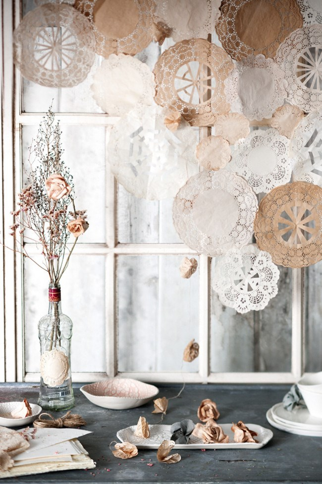 Paper doily feature. Turn humble paper doilies into a pretty backdrop and whimsical garland for your big day. [How to make a doily window feature](http://www.homelife.com.au/craft-diy/knitting-sewing/how-to-make-a-doily-window-shade)