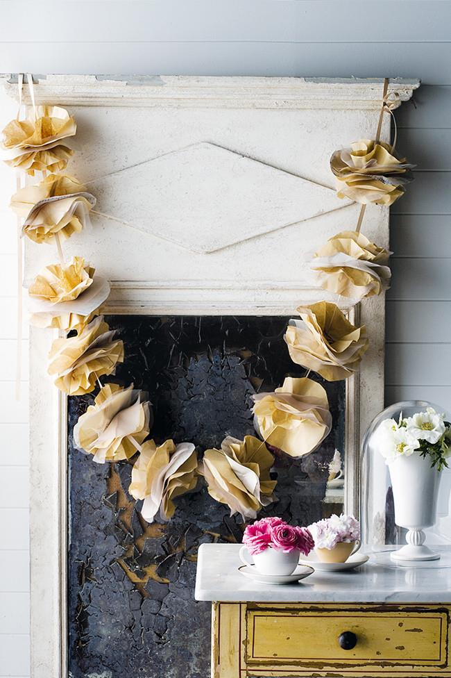 Tulle and paper garland. This gorgeous paper and tulle garland was made using unbleached coffee filters, tulle, organza and sheet music. You could use any combination of paper and stiff, filmy fabric to suit your wedding colour scheme. [How to make a tulle and paper garland](http://www.homelife.com.au/craft-diy/craft/how-to-make-a-garland)