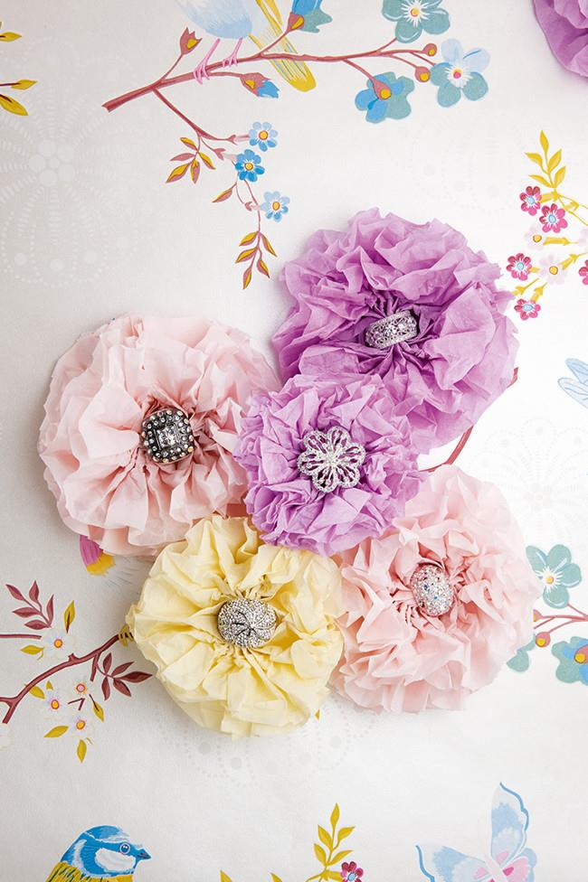 Paper flowers. Add flutters of colour and texture to your wedding with gorgeous paper flowers. String them on fishing wire, secure with pins to fabric or curtains; you could even add them to clothing as a brooch. Look for unique coloured paper and textures for amazing results. [How to make paper flowers](http://www.homelife.com.au/craft-diy/diy/how-to-make-paper-flowers)