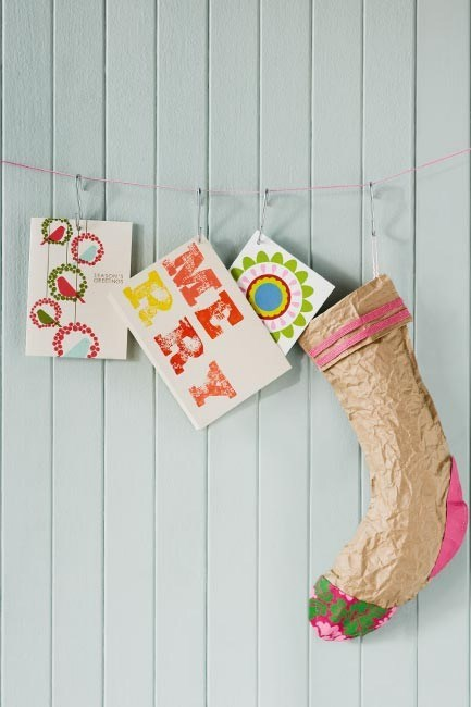 """**Christmas card hanging display**: Christmas cards don't have to stand up. Move them away from the mantelpiece or shelves and string them up using 'S' hooks. [Arrange your cards](https://www.homestolove.com.au/3-ways-to-decorate-with-christmas-cards-10221