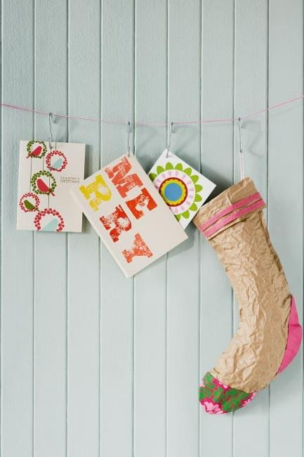 "**Christmas card hanging display**: Christmas cards don't have to stand up. Move them away from the mantelpiece or shelves and string them up using 'S' hooks. [Arrange your cards](https://www.homestolove.com.au/3-ways-to-decorate-with-christmas-cards-10221|target=""_blank"") with a harmonised colour scheme to create an artful display. Small timber pegs and silver bulldog clips will also work for this display."