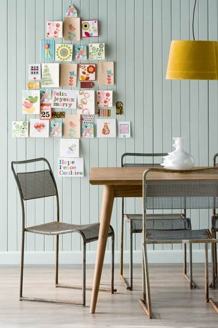 **Tree of Christmas cards**: Show off your season's greetings in an elegant way by arranging your cards on a wall in the shape of a Christmas tree. Use Blu-Tack or similar to stick up the cards. This means you can easily rearrange or add to the collection.