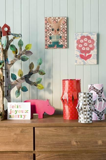 **DIY paper lanterns**: Cut some slits into a rectangular piece of card, join at both ends and press down to form the shape. For the best results, use medium-weight papers or cardboard. Cut them to varying heights for an eye-catching display.