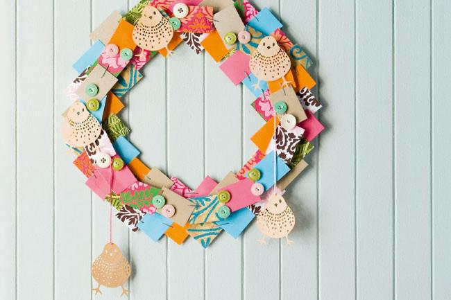 **Fabric wreath**: To make a wreath that really lasts, raid the wrapping-paper stash and search for offcuts in the sewing basket. Cut them into squares and layer them onto a cardboard ring to create a mini masterpiece. Finish it all off by adorning your handmade wreath with details such as bird cut-outs and buttons.