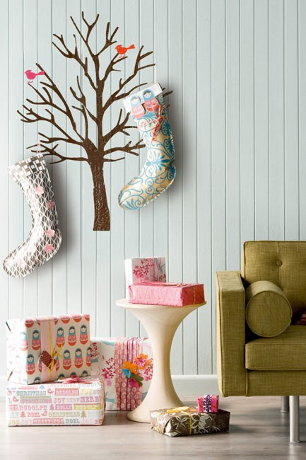 """**Christmas tree decal**: Go minimalist and replace the traditional tree with a quaint decal that catches the eye and cuts the clutter. You can [adorn it with decorations](https://www.homestolove.com.au/christmas-decorating-checklist-4485