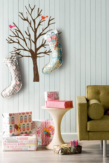 "**Christmas tree decal**: Go minimalist and replace the traditional tree with a quaint decal that catches the eye and cuts the clutter. You can [adorn it with decorations](https://www.homestolove.com.au/christmas-decorating-checklist-4485|target=""_blank"") - or a pair of Christmas stockings - by adding hooks to the branches, thereby giving the display added practicality."