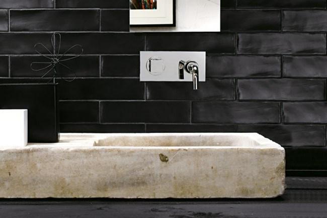'Amano' wall tiles (75mm x 300mm) in matt black, from [Academy Tiles](http://www.academytiles.com.au/).