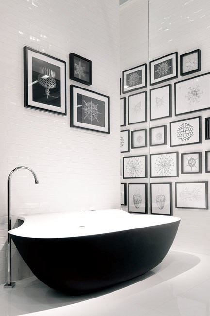 Direct from Italy comes the latest news in bathrooms: the Falper 'Scoop' bath by Michael Schmidt. The organic oval shape is enhanced by the use of a new stone-like material, called Cristalplant, and a 'softtouch' exterior in matt black. The bath can also be   teamed with a matching pedestal basin and mirror. [From Rogerseller](http://www.rogerseller.com.au)  Image courtesy of Rogerseller
