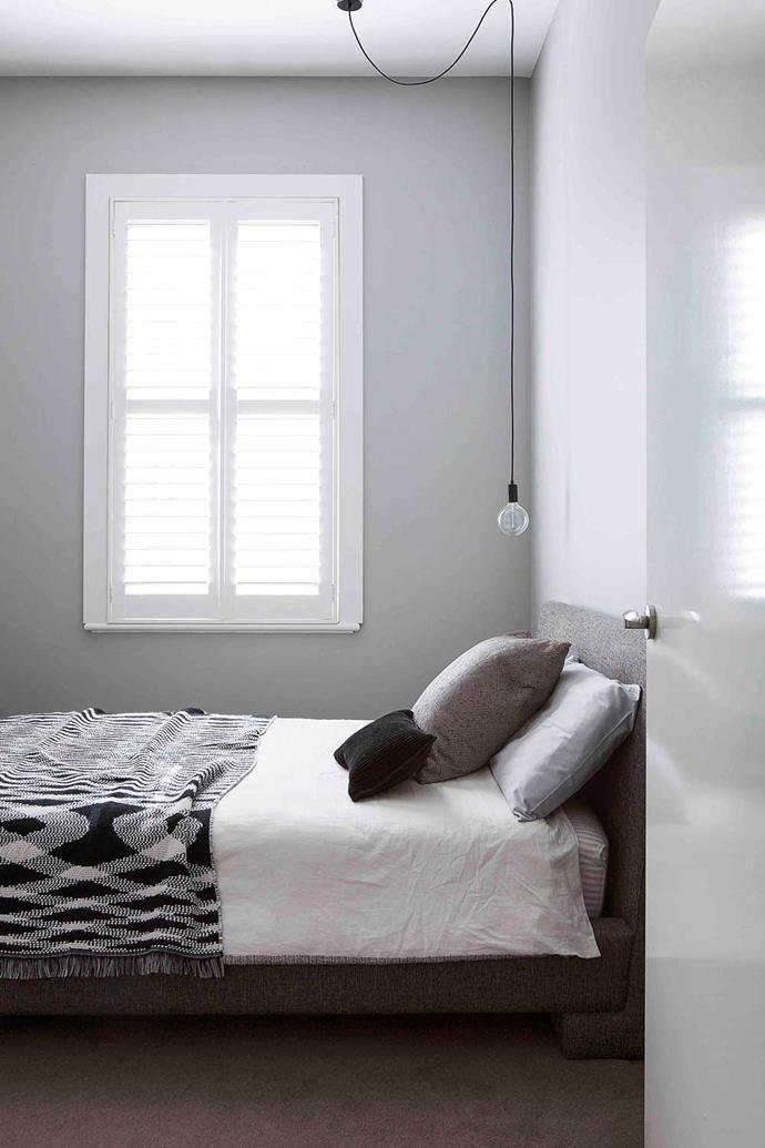Max's bedroom features grown-up greys via walls painted in Dulux's Silkwort, Bedouin Societe bedlinen and a Missoni throw