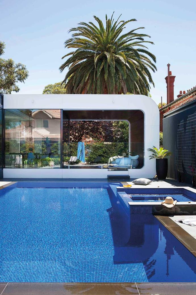 Graceful curved box of an outdoor room, alongside a glittering pool bedecked in Spanish blue glass mosaics