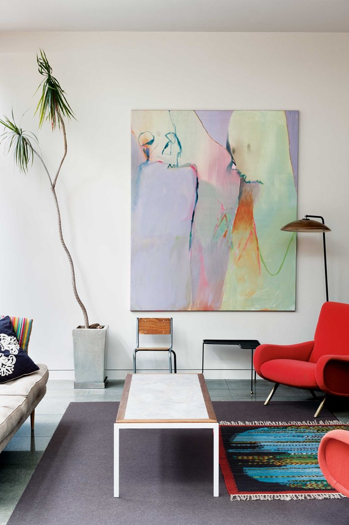 Go crazy with colour. One of the best ways to distract people from your shabby carpets and rental beige walls is with colour. Whether it's in your furniture, cushions or the art on your walls; the brighter, the better.  | Photo: Marcel Aucar