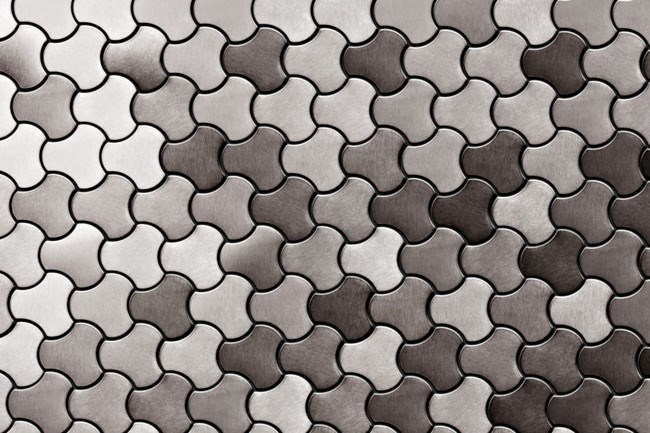 **Tile design** | The boldly creative Karim Rashid has joined with Alloy Design, local lovers of all things metal, to create a range of tiles. The 'Ubiquity' pattern is made from brushed stainless steel and can be bought by the sheet, from [Alloy Design](http://www.alloydesign.com.au).