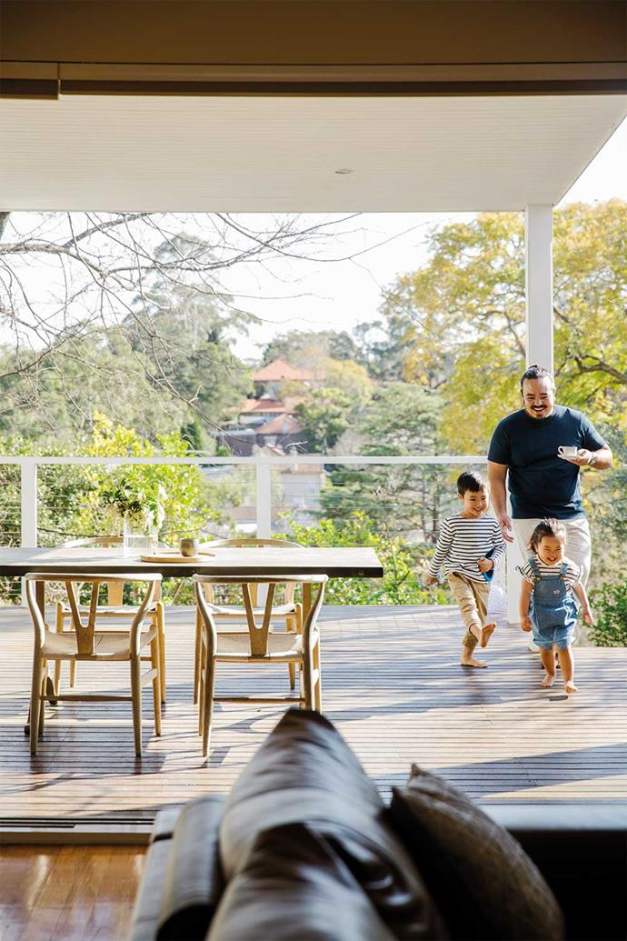 Adam pictured on the deck of his family home with Christopher and Anna