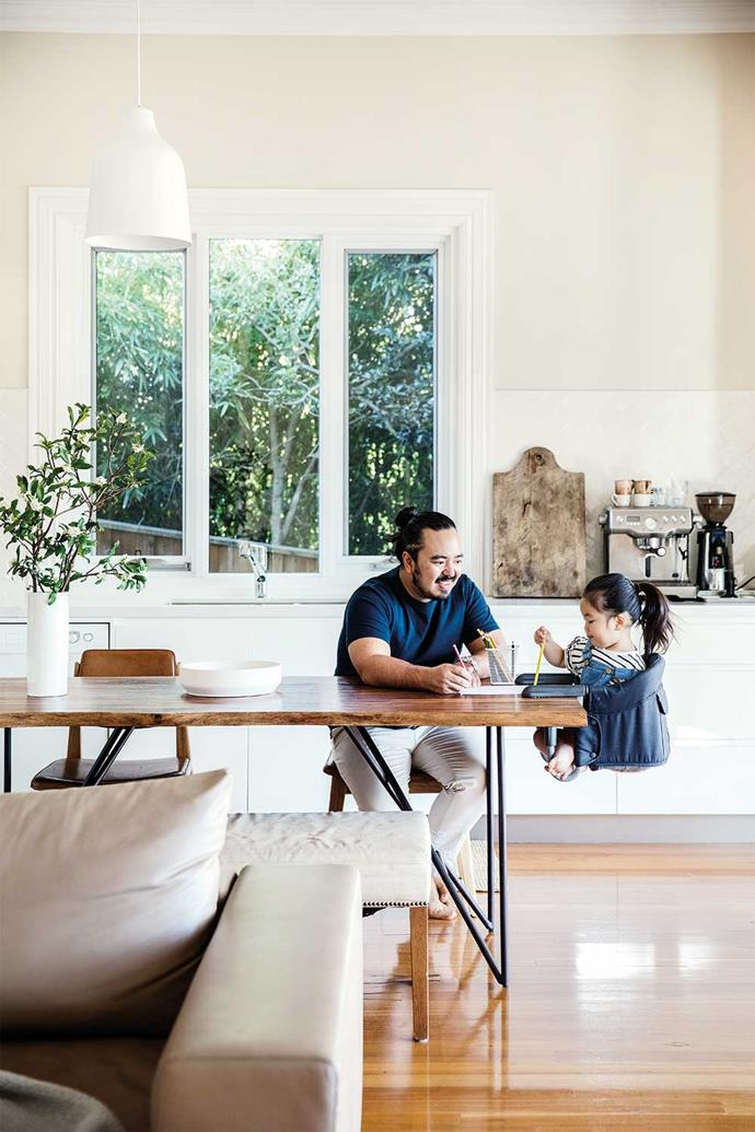 Anna takes a seat at the dining table with dad, Adam. For a similar chair, try the 'Fast Table Chair' in Black from Amazon