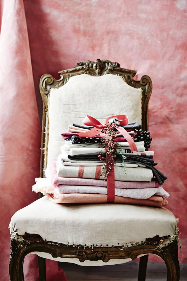 """Keep all your holiday linen and napery together by tying them together with a pretty bow - one from an unwrapped [Christmas gift](https://www.homestolove.com.au/christmas-gifts-for-50-and-under-4460 
