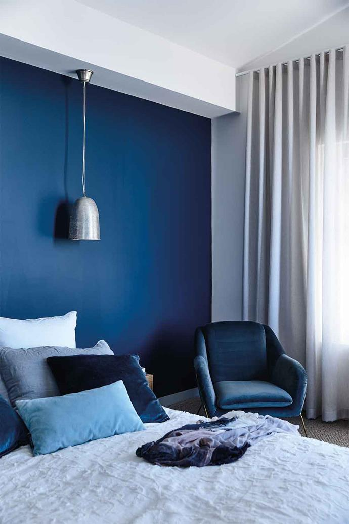 Bedroom walls swathed in Dulux Sharp Blue provide instant immersion in the watery tone