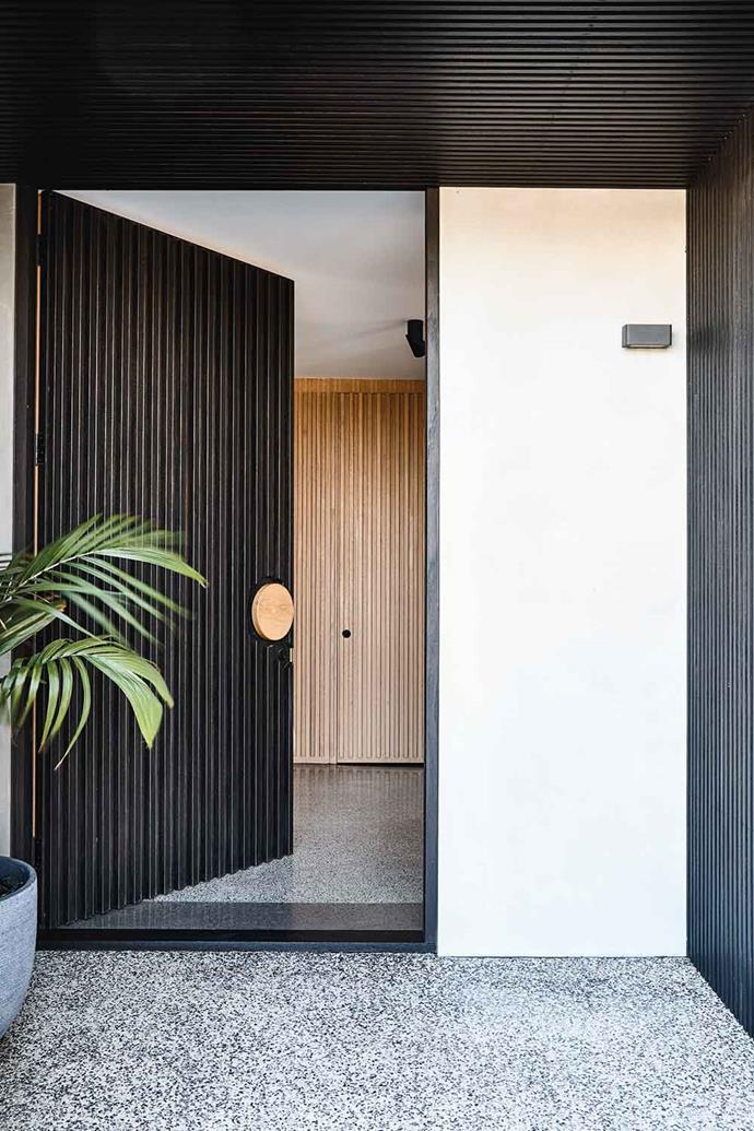 Designed by Tina, the front door is European Oak stained in Resene Sheer Black