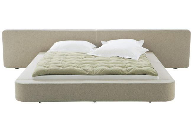 Ligne Roset 'Cemia' queen-size bed with wide headboard by Peter Maly, from [Domo Collections](http://www.domo.com.au/)[](http://www.domo.com.au/).