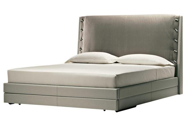 Poltrona Frau 'Alta Fedelta' queen-size bed in leather with fabric headboard cover by Daniela Puppa, from Space.