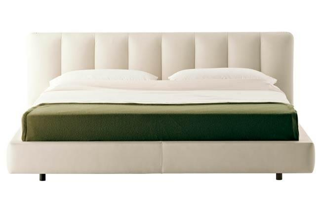 Poltrona Frau 'Flavia' by Patrick Norguet, from [Space](http://www.spacefurniture.com.au/). A contemporary/classic blend, with strong vertical detailing in the padded headboard.