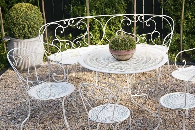 **Create your own romantic garden** | This 1940's wrought-iron garden setting could be the perfect decor in your romantic garden at home.