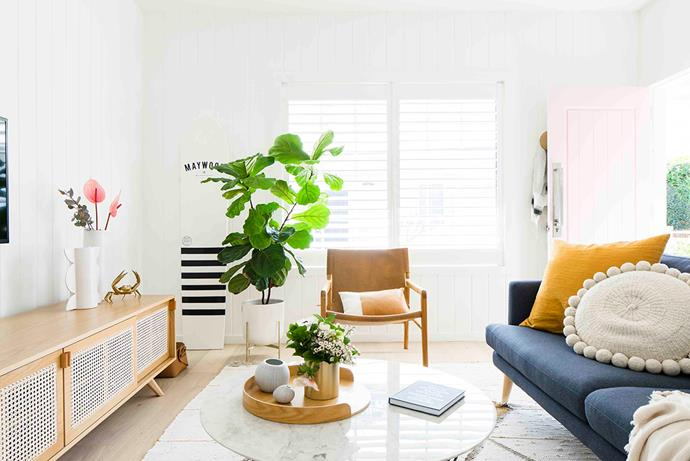 With its denim 'Hugo' sofa from Lounge Lovers, sandy-hued Kira & Kira 'The Iconic' sideboard and sunshine-yellow Smithmade cushion, the lounge room takes colour cues from its seaside locale.