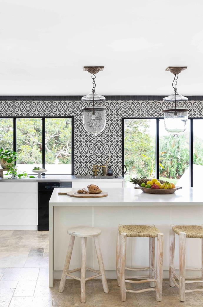 Patterned Jatana tiles from benchtop to ceiling steal the show in the kitchen.