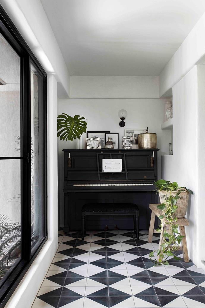 Previously a veranda, this space was enclosed to create a hallway, where one end is the perfect width to accommodate a piano that has been in Brad's family for three generations.