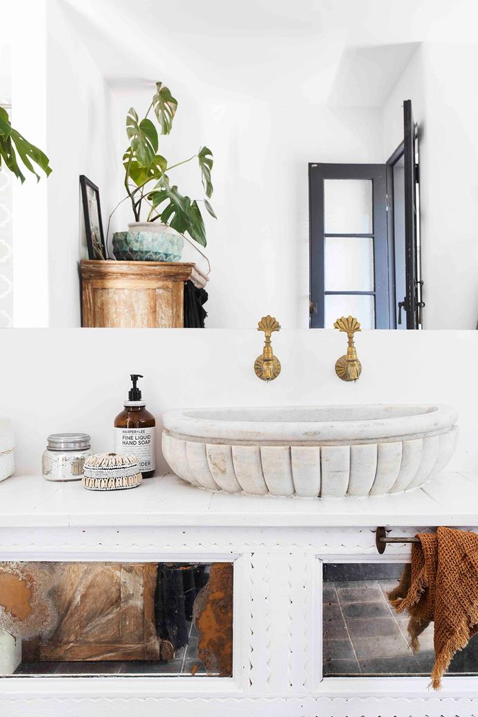 Vintage cabinet from Ha'veli, Ottoman Imports brass taps and a marble basin from Bisque Traders.