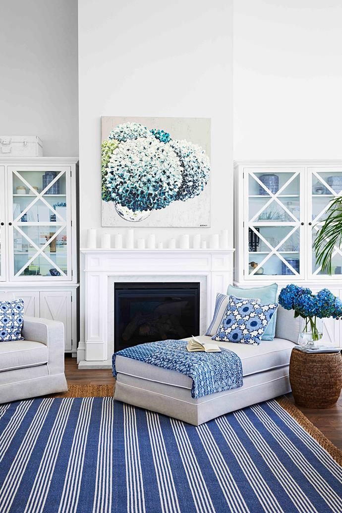 Big, blowsy hydrangeas are synonymous with the Hamptons and are also one of Natalee's favourite flowers, so the 'Club Hamptons' artwork by Felicia Aroney takes pride of place above the charming fireplace mantel.